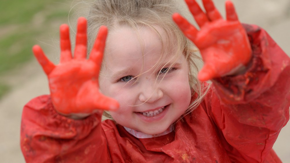child painting hands