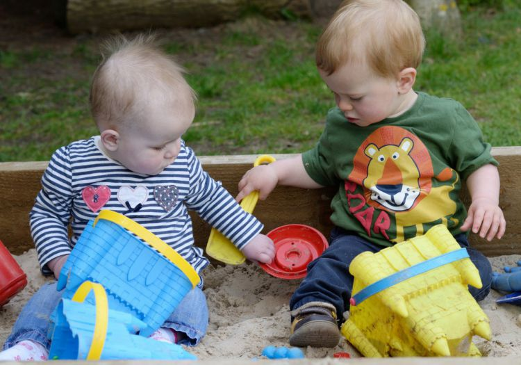 babies in sand pit