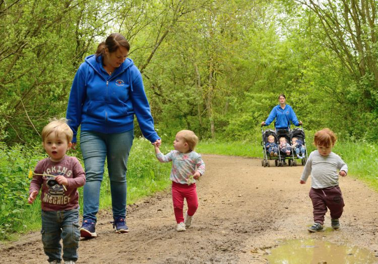 babies and toddlers on walk in woods