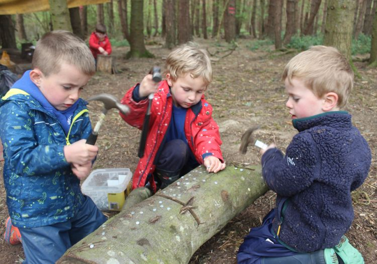 Forest School, 10 years, outdoor learning, tool work, hammering, independent learning